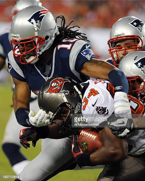 Wide receiver Jesse Holley of the New England Patriots tackles running back Michael Smith of the Tampa Bay Buccaneers at Raymond James Stadium in a...