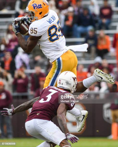 Wide receiver Jester Weah of the Pittsburgh Panthers makes a reception while being defended by cornerback Greg Stroman of the Virginia Tech Hokies in...