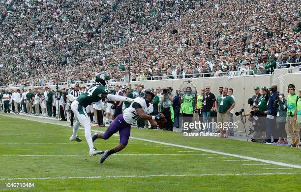 Wide receiver JJ Jefferson of the Northwestern Wildcats makes a 34yard touchdown reception against safety Tre Person of the Michigan State Spartans...