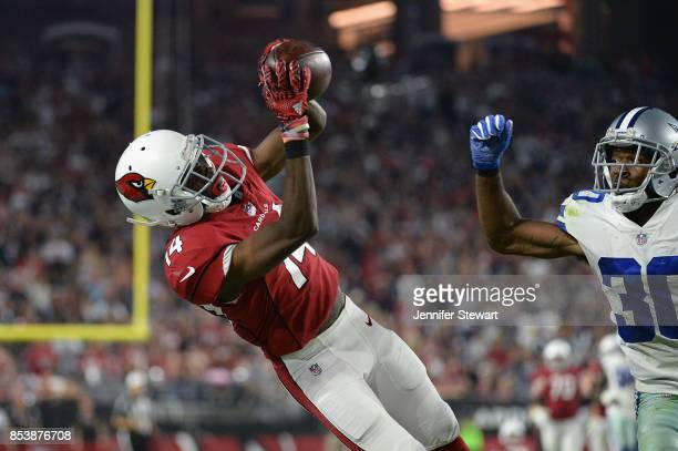 Wide receiver JJ Nelson of the Arizona Cardinals hauls in a catch over cornerback Anthony Brown of the Dallas Cowboys during the second half of the...