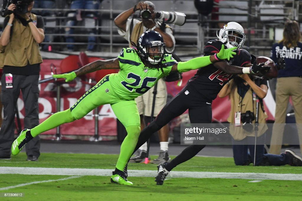 Wide receiver J.J. Nelson #14 of the Arizona Cardinals is unable to completed the pass against cornerback Shaquill Griffin #26 of the Seattle Seahawks in the first half of the NFL game at University of Phoenix Stadium on November 9, 2017 in Glendale, Arizona.