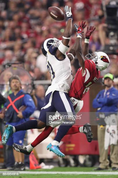 Wide receiver JJ Nelson of the Arizona Cardinals makes a catch over cornerback Kayvon Webster of the Los Angeles Rams during the second quarter of...