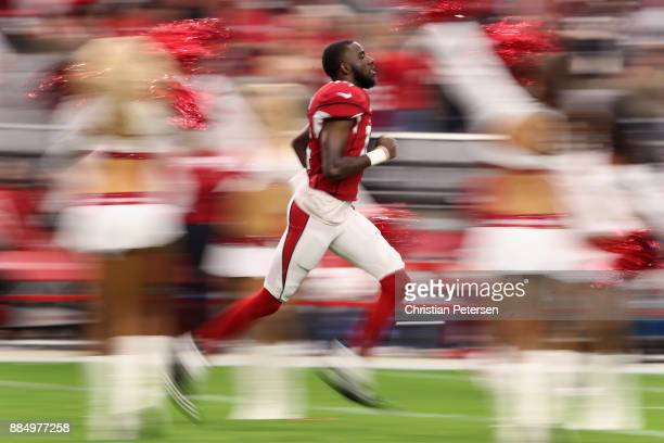Wide receiver JJ Nelson of the Arizona Cardinals runs onto the field for introductions before the NFL game against the Los Angeles Rams at the...