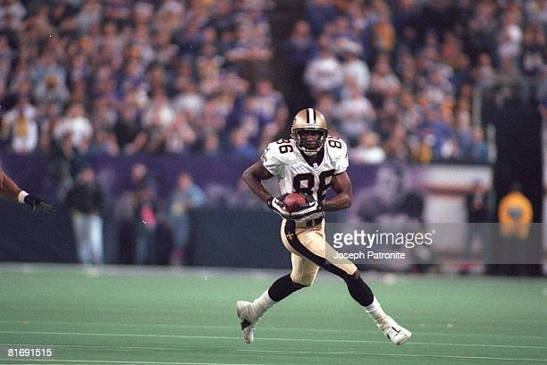Wide receiver Joe Horn of the New Orleans Saints runs upfield with an reception against the Minnesota Vikings in the 2000 NFC Divisional Playoff Game...