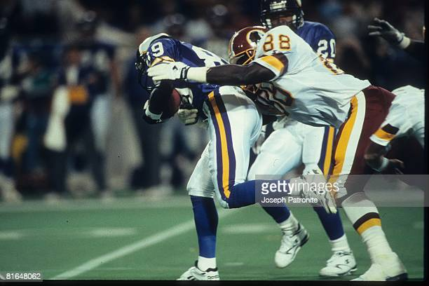 Wide receiver Joe Johnson of the Minnesota Vikings is caught tight end James Jenkins of the Washington Redskins on a kick return in the 1992 NFC...