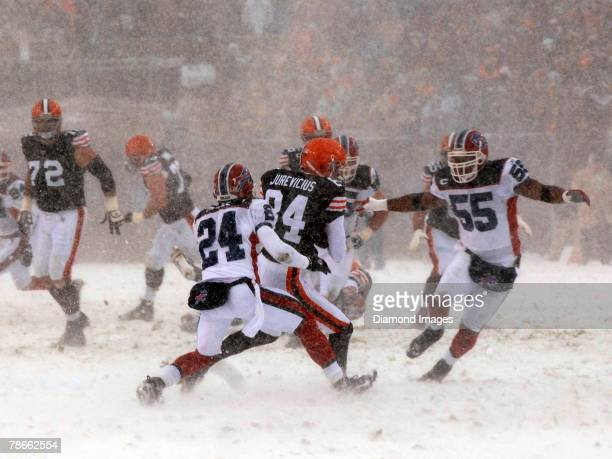 Wide receiver Joe Jurevicius of the Cleveland Browns catches a pass between Terrence McGee and Angelo Crowell of the Buffalo Bills during a game on...