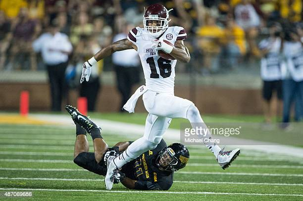 Wide receiver Joe Morrow of the Mississippi State Bulldogs leaps in the air to dodge a tackle from defensive back Kalan Reed of the Southern Miss...
