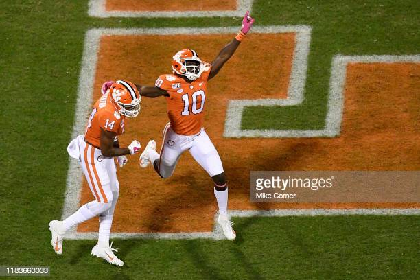 Wide receiver Joe Ngata celebrates with wide receiver Diondre Overton of the Clemson Tigers after Overton scores a touchdown against the Boston...