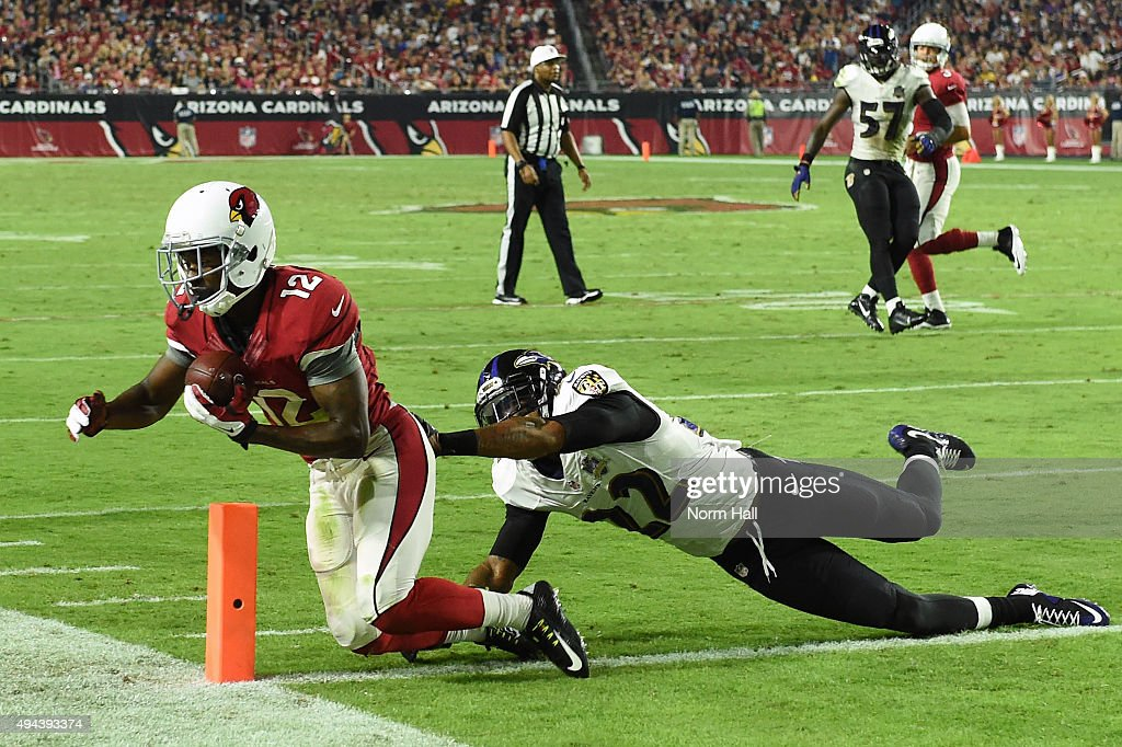 Wide receiver John Brown #12 of the Arizona Cardinals scores a touchdown against the cornerback Jimmy Smith #22 of the Baltimore Ravens in the fourth quarter of the NFL game at University of Phoenix Stadium on October 26, 2015 in Glendale, Arizona.
