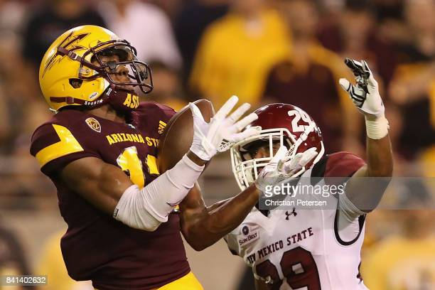 Wide receiver John Humphrey of the Arizona State Sun Devils catches a 60 yard touchdown reception past defensive back Jared Phipps of the New Mexico...