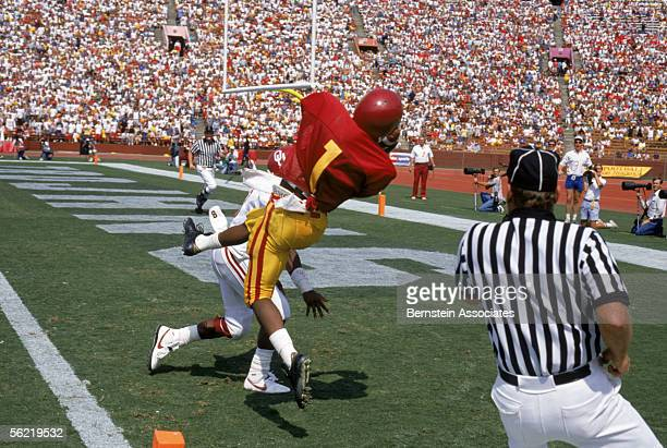 Wide receiver John Jackson of the USC Trojans catches a touchdown pass against the Oklahoma Sooners at the Coliseum on September 24 1988 in Los...