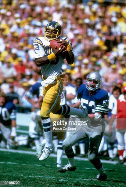 Wide Receiver John Jefferson of the San Diego Chargers catches a pass in front of linebacker Keith Butler of the Seattle Seahawks circa late 1970's...
