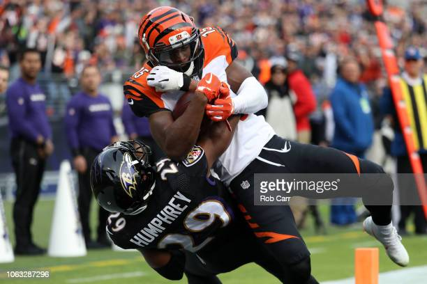 Wide Receiver John Ross of the Cincinnati Bengals catches a touchdown as he is tackled by cornerback Marlon Humphrey of the Baltimore Ravens in the...