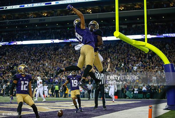Wide receiver John Ross of the Washington Huskies is congratulated by wide receiver Dante Pettis after scoring a touchdown against the Stanford...