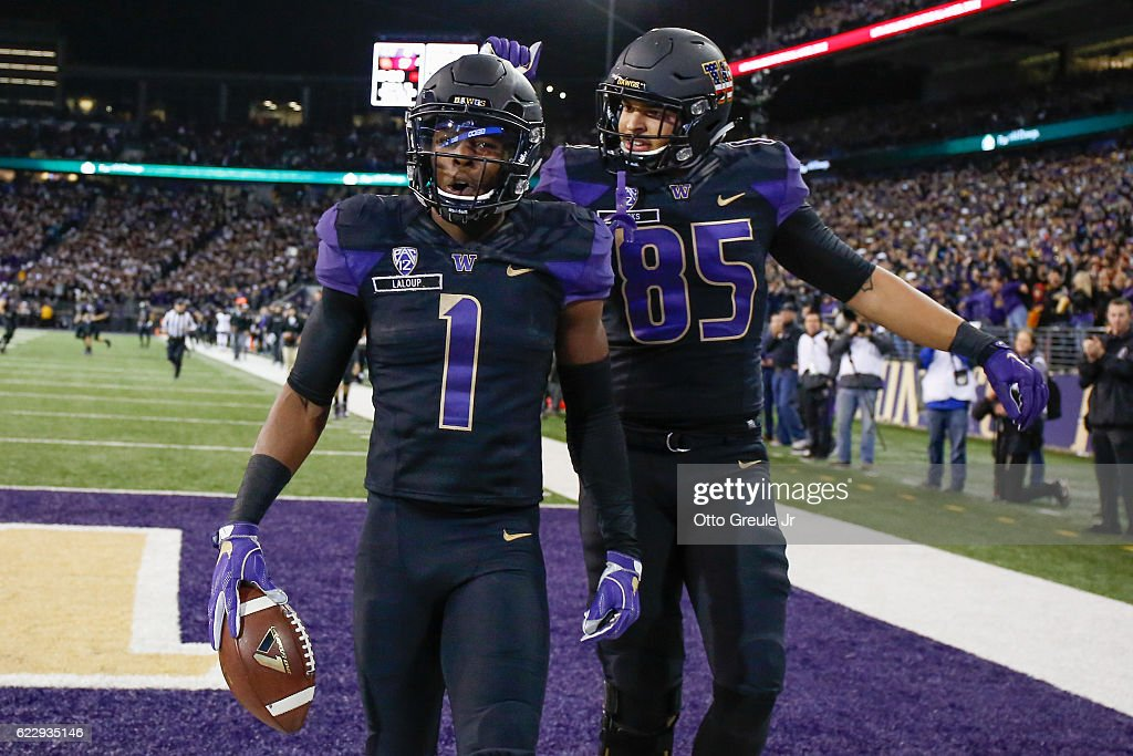 Wide receiver John Ross #1 of the Washington Huskies is congratulated by tight end David Ajamu #85 after scoring a touchdown against the USC Trojans on November 12, 2016 at Husky Stadium in Seattle, Washington. The Trojans defeated the Huskies 24-13.