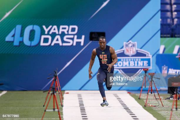 Wide receiver John Ross of Washington runs the 40-yard dash in an unofficial record time of 4.22 seconds during day four of the NFL Combine at Lucas...