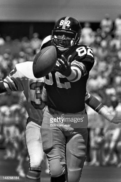 Wide receiver John Stallworth of the Pittsburgh Steelers watches a pass roll off his fingertips during the game against the Houston Oilers on...