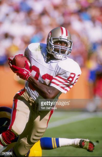 Wide receiver John Taylor of the San Francisco 49ers runs down the field during a game against the Los Angeles Rams at Anaheim Stadium in Anaheim...