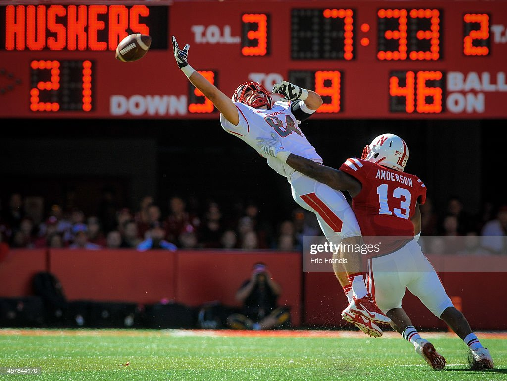 Wide receiver John Tsimis #84 of the Rutgers Scarlet Knights misses a pass over linebacker Zaire Anderson #13 of the Nebraska Cornhuskers during their game at Memorial Stadium on October 25, 2014 in Lincoln, Nebraska.