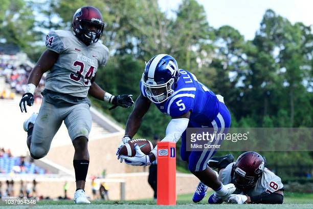 Defensive back Jordan McRae of the North Carolina Central Eagles runs in a long turnover for a touchdown against the Duke Blue Devils during the...