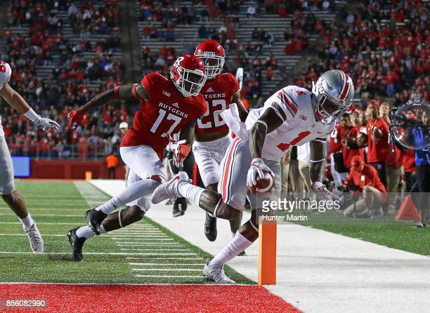 Wide receiver Johnnie Dixon of the Ohio State Buckeyes catches a 39 yard touchdown pass in the second quarter during a game against the Rutgers...