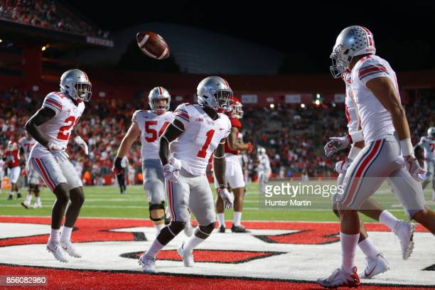 Wide receiver Johnnie Dixon of the Ohio State Buckeyes celebrates after scoring a 39 yard touchdown pass in the second quarter during a game against...