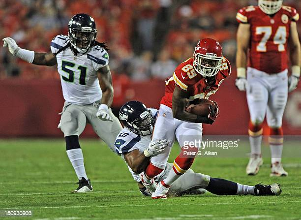 Wide receiver Jon Baldwin of the Kansas City Chiefs turns up field against linebacker KJ Wright of the Seattle Seahawks during the second half of a...