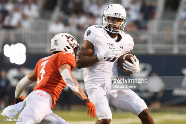 Wide receiver Jonathan Duhart of the Old Dominion Monarchs advances the ball following his reception in the second half against the Virginia Tech...