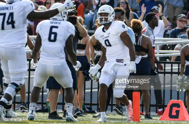 Wide receiver Jonathan Duhart of the Old Dominion Monarchs celebrates his touchdown reception against the Virginia Tech Hokies in the first half at S...
