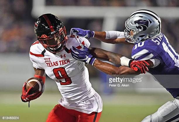 Wide receiver Jonathan Giles of the Texas Tech Red Raiders fights off defender Donnie Starks of the Kansas State Wildcats during the first half on...