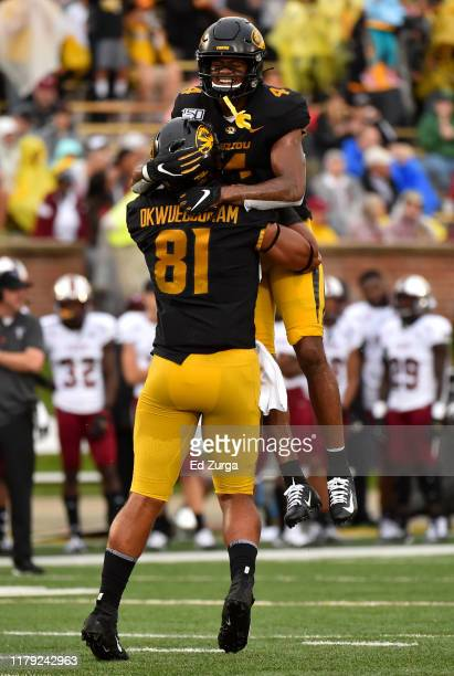 Wide receiver Jonathan Nance of the Missouri Tigers celebrates his 64-yard touchdown run with tight end Albert Okwuegbunam against the Troy Trojans...