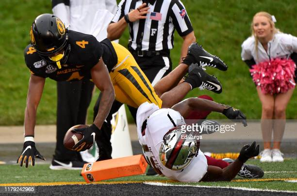 Wide receiver Jonathan Nance of the Missouri Tigers dives into the end zone for a 64yard touchdown against cornerback Dell Pettus of the Troy Trojans...