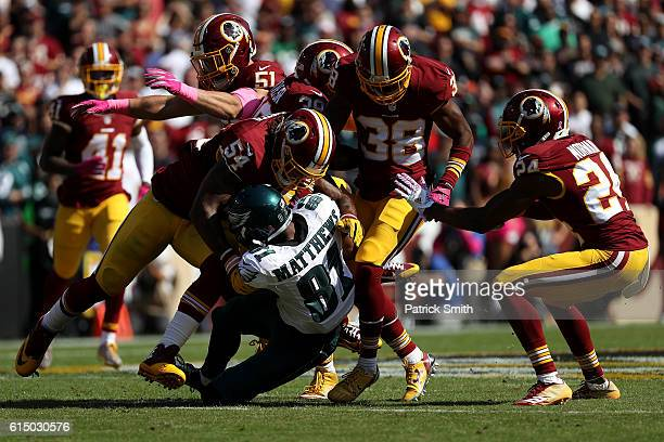 Wide receiver Jordan Matthews of the Philadelphia Eagles is tackled by inside linebacker Mason Foster of the Washington Redskins in the first quarter...