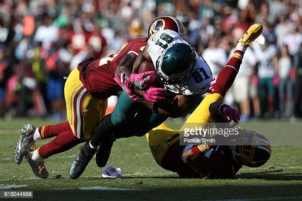 Wide receiver Jordan Matthews of the Philadelphia Eagles is tackled by cornerback Kendall Fuller and free safety Will Blackmon of the Washington...