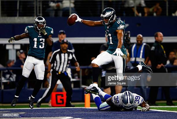 Wide receiver Jordan Matthews of the Philadelphia Eagles leaps over cornerback Brandon Carr of the Dallas Cowboys to score the gamewinning touchdown...