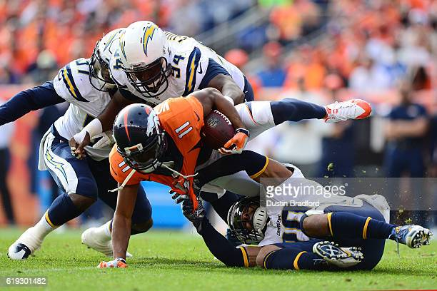 Wide receiver Jordan Norwood of the Denver Broncos is dragged down by free safety Dwight Lowery of the San Diego Chargers in the second quarter of...