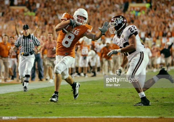 Wide receiver Jordan Shipley of the Texas Longhorns sets up a touchdown with a 68yard gain against defensive back Trent Hunter of the Texas AM Aggies...