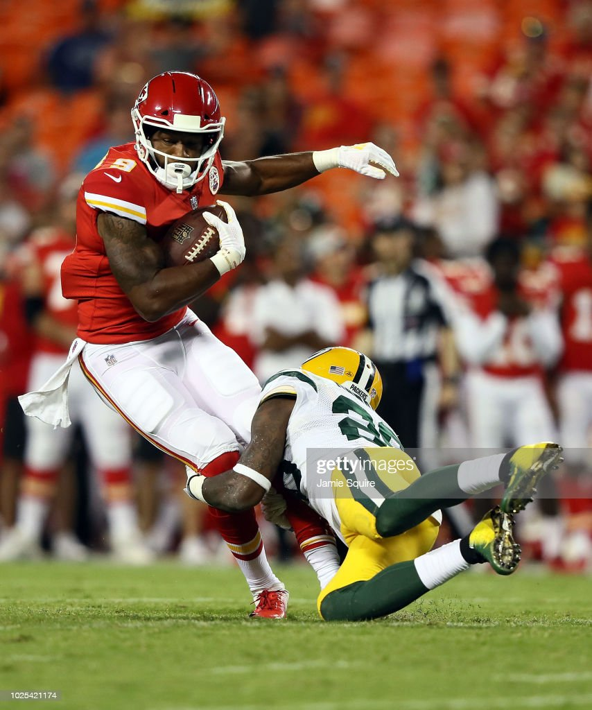 Wide receiver Jordan Smallwood #9 of the Kansas City Chiefs catches a pass as cornerback Josh Hawkins #28 of the Green Bay Packers defends during the preseason game at Arrowhead Stadium on August 30, 2018 in Kansas City, Missouri.
