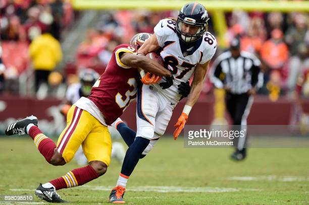 Wide receiver Jordan Taylor of the Denver Broncos is tackled by cornerback Fabian Moreau of the Washington Redskins after catching a pass in the...