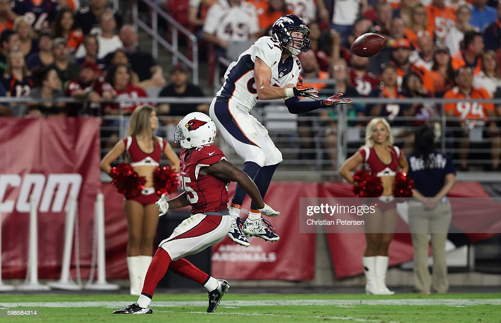 Wide receiver Jordan Taylor #87 of the Denver Broncos makes a leaping catch on a 32 yard reception over defensive back Cariel Brooks #35 of the Arizona Cardinals during the third quarter of the preseaon NFL game at the University of Phoenix Stadium on September 1, 2016 in Glendale, Arizona. The Cardinals defeated the Broncos 38-17.