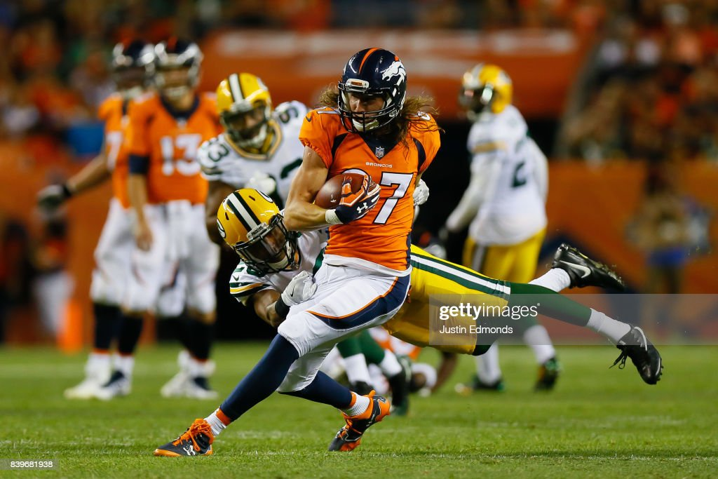 Wide receiver Jordan Taylor #87 of the Denver Broncos sheds a tackle attempt from cornerback Kevin King #20 of the Green Bay Packers after catching a pass in the second quarter of a Preseason game at Sports Authority Field at Mile High on August 26, 2017 in Denver, Colorado.