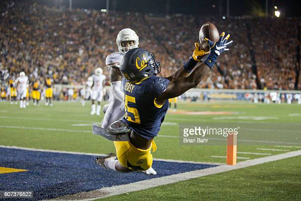 Wide receiver Jordan Veasy of the California Golden Bears can't get his feet in bounds for a touchdown against safety PJ Locke III of the Texas...