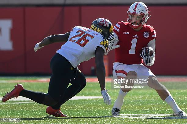 Wide receiver Jordan Westerkamp of the Nebraska Cornhuskers avoids a tackle from defensive back Darnell Savage Jr #26 of the Maryland Terrapins at...