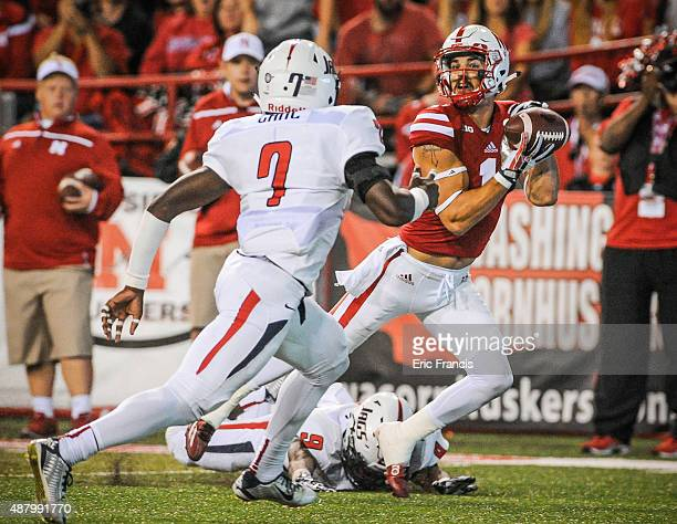 Wide receiver Jordan Westerkamp of the Nebraska Cornhuskers makes a touchdown reception over safety Devon Earl of the South Alabama Jaguars during a...