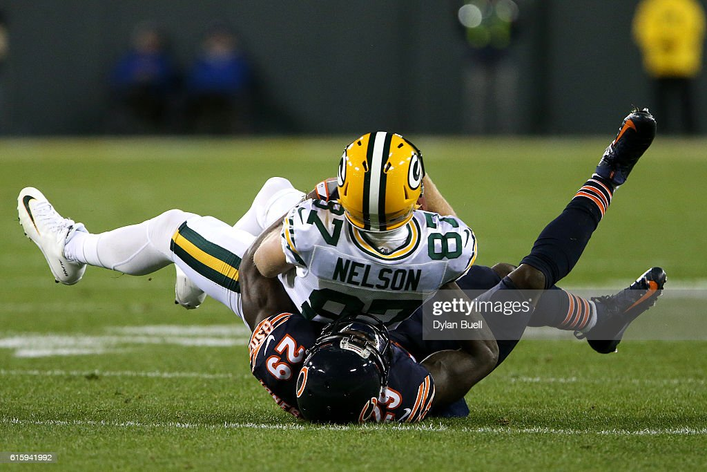 Wide receiver Jordy Nelson #87 of the Green Bay Packers is tackled by strong safety Harold Jones-Quartey #29 of the Chicago Bears in the first quarter at Lambeau Field on October 20, 2016 in Green Bay, Wisconsin.