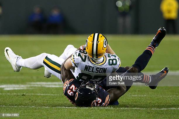 Wide receiver Jordy Nelson of the Green Bay Packers is tackled by strong safety Harold Jones-Quartey of the Chicago Bears in the first quarter at...