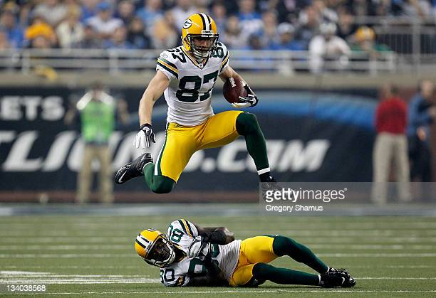 Wide receiver Jordy Nelson of the Green Bay Packers leaps over teammate Donald Driver in the third quarter against the Detroit Lions during the...