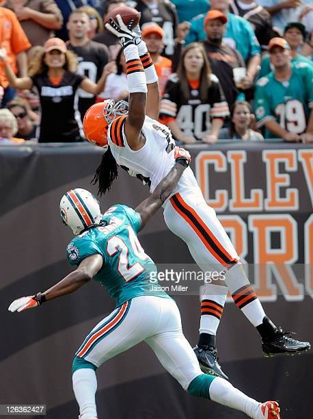 Wide Receiver Josh Cribbs of the Cleveland Browns catches a touchdown pass over cornerback Sean Smith of the Miami Dolphins during the second quarter...