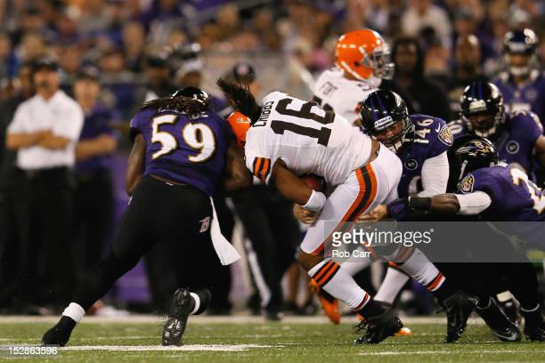 Wide receiver Josh Cribbs of the Cleveland Browns gets hit by linebacker Dannell Ellerbe of the Baltimore Ravens after a play in the first quarter...