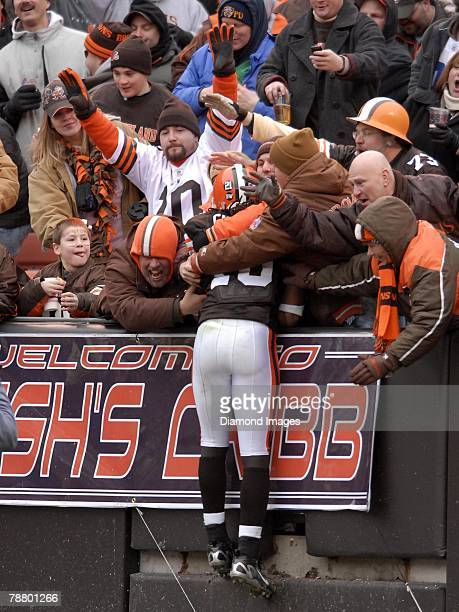 Wide receiver Josh Cribbs of the Cleveland Browns is welcomed by fans into the 'Dawg Pound' after returning a kick during a game with the San...